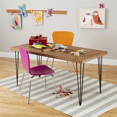 After making the table myself, find the kid version of the adult size chairs we already have.  4 different colors would be great!