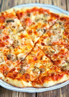 New York Style Pizza Dough Recipe - only 4 ingredients to make the best pizza dough - this dough is so easy to work with! Make the dough and refrigerate until ready to use. Can make up to 3 or 4 days in advance.
