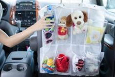 Use a shoe organizer in your car to store your kid's things.