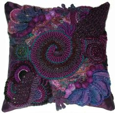This is a crochet blog. I LOVE the colors in this crazy pillow!