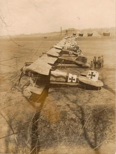 """German Albatros D.III"""" fighters of elite squadron Jasta 11, known as """"Flying Circus"""" at Roucourt photographed during the spring of 1917. The 2nd closest aircraft is piloted by Manfred von Richthofen, the """"Red Baron""""."""