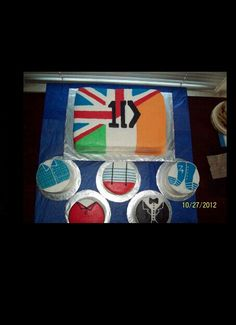 Yummie! One Direction cake! Perfect for my birthday! One for each little cupcake for each of my friends: Liam is for me... Niall is for @♥Grace♥ *TBCI* Harry is for @MEOWdeleine (Madeleine) Elizabeth Louis for @Kennedy Skinner and Zayn for my little sister