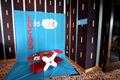 Cardboard plane photo booth for Airplane birthday party by Victoria Chow.
