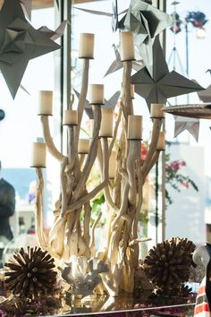 A driftwood candelabra was the focal point of the seating card display in this beachside wedding.  Design by Alchemy Fine Events  www.alchemyfineevents.com