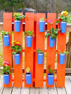 painted old pallets for garden / deck decor to hold an herb and/or flower garden. Brighten up your outdoor space with bright bold colors.