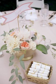 "From GG: ""Jacin spray-painted plastic bowls gold for our flower displays. She also spray-painted small wicker baskets to match.  They had BBQ wipes and bibs for guests to keep clean at dinner."""