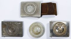 Lot 346: World War II German Belt Buckle Assortment; Four items including a Labor Corp officer buckle, two SS buckles and a round officer buckle