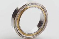Strata ring by Mari Thomas. Layers of silver and 22k gold.