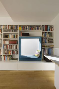 10 Reading Nooks Perfect For Curling Up In // A padded window seat surround makes this nook a cozy place to relax and read.