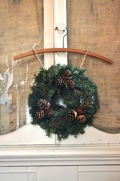 From Jennifer Rizzo: Welcome to the virtual holiday house walk (2011).  I like this idea for hanging the wreath.