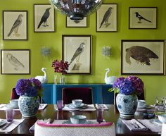 I love the strong colors, two-toned chairs (upholstered in claret mohair and lavender and white China Seas cotton, joined by green welting),  chartreuse walls, blue lacquered console, and the framed birds. By Katie Ridder.