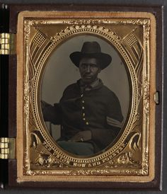 [Unidentified African American soldier in Union corporal's uniform]  [between 1863 and 1865]  1 photograph : ninth-plate tintype, hand-colored ; 7.5 x 6.4 cm (case)  Notes:  Title devised by Library staff. Case: Berg, no. 3-276. Use digital images. Original served only by appointment because material requires special handling. For more information see: (www.loc.gov/rr/print/info/617_apptonly.html) Deposit; Tom Liljenquist; 2012; (D066) Purchased from: George S. Whiteley IV, Atlanta, Ga…