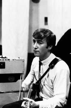 John during an early recording session - The Beatles