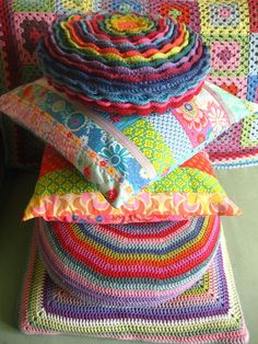 Pretty home-made strip quilted cushion covers, and a couple of crochet covers too :)  from Attic 24