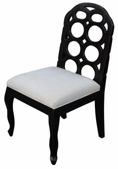 Dining chair with circle detailSolid Alderwood constructionFinishes in a satin blackLinen/cotton blend seat cushionAvailable In Other FabricsAlso Available As An Arm Chair