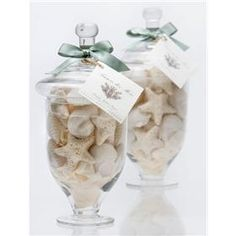 Apothecary Jars filled with shell shaped soaps or real shells.... I wouldn't want someone using my gorgeous soaps anyway...