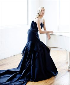 navy wedding dress - don't feel your wedding dress has to be ivory or white. You can make a dramatic entrance in a coloured wedding dress.