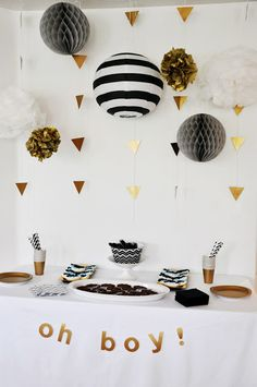 BANNER: white/ black/ gold decor - we can put a bunch of pom poms together to create a big statement banner