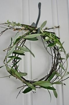 Olive branch and pussywillow wreath.