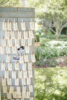 escort cards strung from an old door. guests were asked to take a fun polaroid and replace the card with their image as they took their seats Photography by Paper Antler / paperantler.com