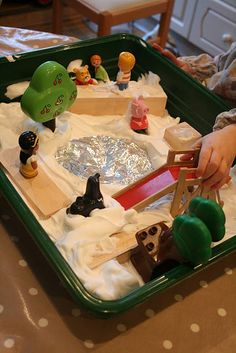 Small World Play: The Park in the Snow. Shaving foam sensory tub.