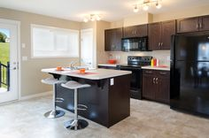 The Octic Showhome kitchen in Walker Summit designed to make the best use of the space with a large island and extra sitting room Morrison Homes, Luxury Estate, Home Builders, Small Spaces, New Homes, Vibrant, Design Inspiration, Island, Kitchen
