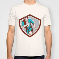 Buy Rugby Player Running Ball Shield Retro by Patrimonio as a high quality T-shirt. Worldwide shipping available at Society6.com. Just one of millions of…