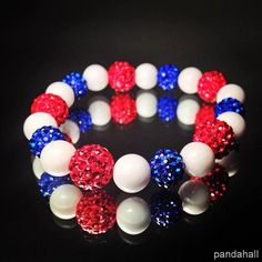 beaded bracelet with blue and red ball beads and gemstone beads