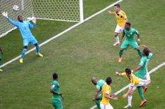 Colombia's midfielder James Rodriguez (bottom-R) scores a goal during the Group C football match between Colombia and Ivory Coast at the Mane Garrincha National Stadium in Brasilia during the 2014 FIFA World Cup on June 19, 2014