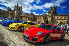 Porsche line-up with Blenheim Palace as the backdrop
