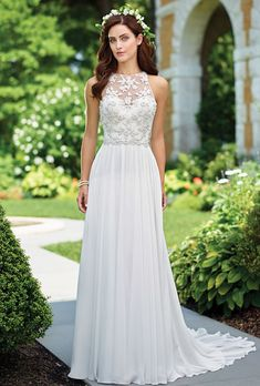 Enchanting by Mon Cheri. Sleeveless chiffon A-line gown with hand-beaded illusion high jewel neckline, hand-pattern beaded sweetheart bodice with natural waist, beaded illusion keyhole back, softly gathered skirt with chapel train.
