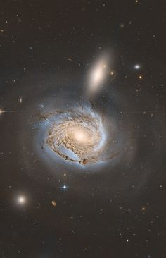 NGC 4522 is a spectacular example of a spiral galaxy that is currently being stripped of its gas content. The galaxy is part of the Virgo galaxy cluster and its rapid motion within the cluster results in strong winds across the galaxy as the gas within is left behind. The galaxy is moving at more than 10 million kilometres per hour and is some 60 million light-years away. Newly formed star clusters that developed in the stripped gas can be seen in this image. Credit: NASA/Hubble, Marco…