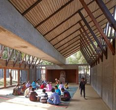Volcanic stone dust was used to build the walls of this Buddhist education and meditation centre, designed by Sameep Padora & Associates for a woodland clearing in rural India.