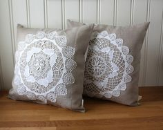 Linen pillows with antique doily applique on top, $95 for two from Tuuni on Etsy
