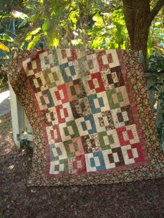 """Split Decision pattern by The Teacher's Pet - uses one Jelly Roll and two borders - an extraordinary and ever so easy quilt.  Make it in one day.  Finished size is 56"""" x 72""""."""