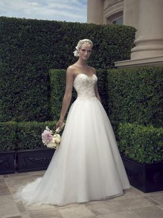 This strapless plunging sweetheart neckline is decorated with beaded sheer illusion tulle triangle panel at the center front neckline to add the perfect amount ...
