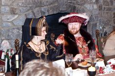 King Henry VIII and Catherine of Aragon enjoy dinner during their visit to Ravenwood Castle.