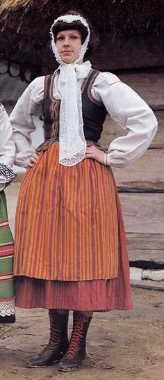 And this is the Radzinsk costume, the tulle bonnet, the striped apron and skirt and the lack of ornamentation on the chemise all contribute to this resembling very closely a purely Polish Mazovian costume. Podlasie