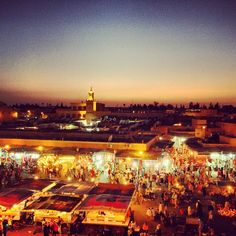 Morrocco: Marrakech: Place Jemaa el-Fna Square : snake-charmers, henna-painters, story-tellers, date-sellers and orange juice vendors