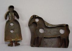"""TWO LARGE TIN COOKIE CUTTERS. Shaker lady. 8 1/4""""h"""