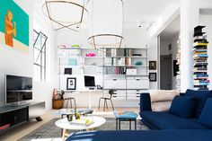 Loft Apartment by Cloud. The designer's description  The apartment, which is in a converted industrial space, was completely reconfigured by Cloud to create two bedrooms and a large open plan living space.