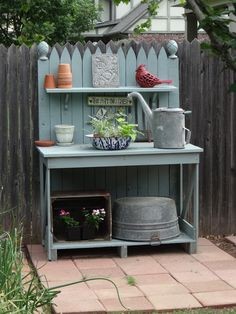 realistic suburban garden, I spied this potting bench, painted just the right shade of blue to offset the terracotta accents and galvanized what-nots. Outdoor Potting Bench, Potting Bench Plans, Potting Tables, Potting Sheds, Garden Projects, Wood Projects, Potting Station, Deco Originale, Garden Table