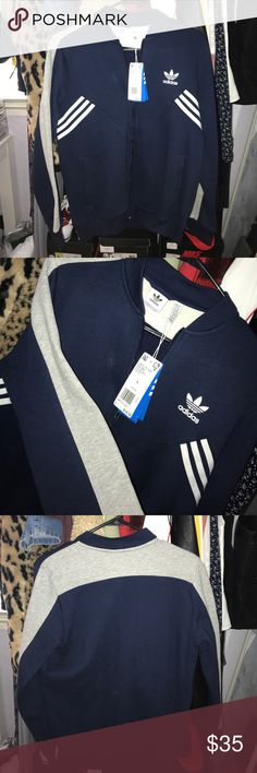 Adidas zip-up! NWT adidas zip-up sweater! Brand new, never worn. Size large in boys, but could fit a small in women's (refer to picture of me trying on the sweater as I am a size small in women's). $55, but $60 after tax. No trades. adidas Sweaters