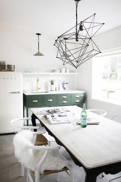 Kitchenette features a wood and iron bar table lined with French