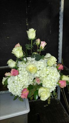 White and pink basket arrangement for a lovely wedding americasflorist.com