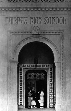 ca. 1931 - Students standing outside the Moorish style archway of the entrance to the Fairfax High School auditorium.