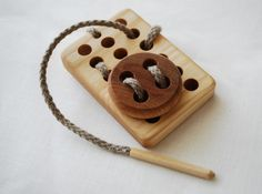 Board with the Button Wooden Toy* Board: 1 X 9 X 6 centimetres (0.4 X 3.5 X 2.4 inches) * Button: 1 X 5 X 5 centimetres (0.4 X 2 X 2 inches)
