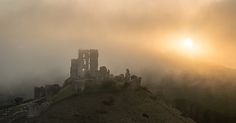 Corfe Castle, Sunset   View of Corfe Castle, Dorset, from East Hill, near sunset as the sea mist rolled in.…  For more check out my website at david Bridgwater photography  Camera Nikon D800/Lee Filters Tripod and head: Legs Manfrotto MT055CXPRO3                                 Head Manfrotto MHXPROBHQ2 Landscape Photographer: David Bridgwater