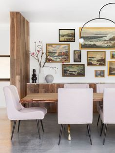pretty pink chairs surround statement wood dining table