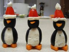 Party Penguins!  Giant olives, stuffed with cream cheese balls, cherry tomato hats, carrots for feet & beak!  Too darn cute!